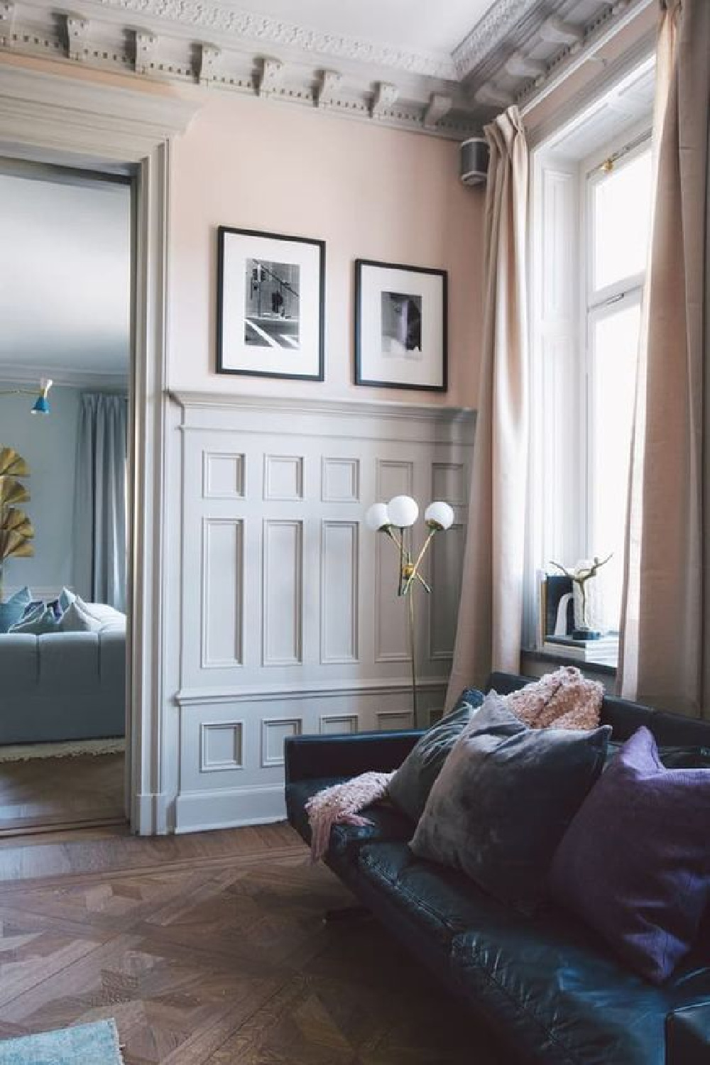 Farrow and Ball Pink Ground in a European home with parquet wood floor and traditional paneled walls.