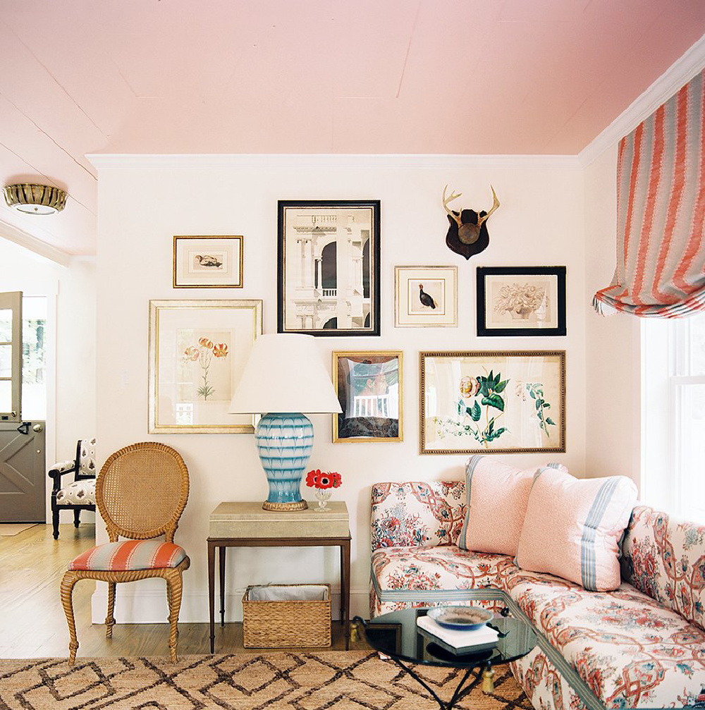 Rosy pink ceiling in chic boho ecelctic den with gallery wall - via HonestlyWTF #pinkpaint #pinkceiling