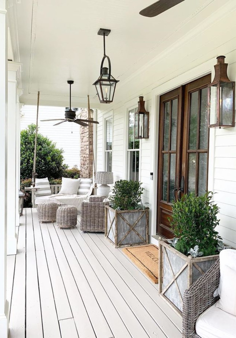 Beautiful Southern porch with Bevolo lanterns, ceiling fans, and outdoor furniture. Linen & Flax Co.Come peek at  Charming Porch Inspiration & Decor Ideas. #southernporch #porchdecor #summerliving #houseexteriors #porchlighting #forntporches