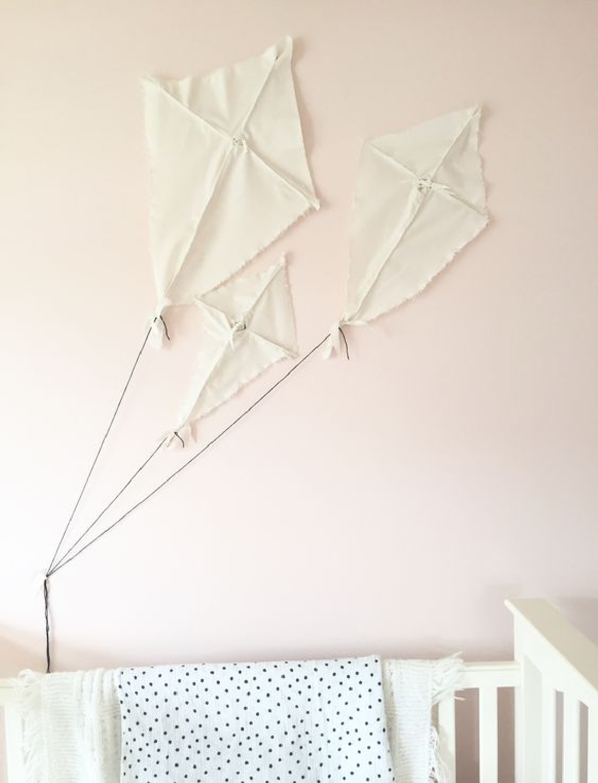 Baby girl nursery kites inspired by hgtv's Fixer Upper. Paint: Sherwin Williams Pink Dogwood. #pinkdogwood #paintcolors