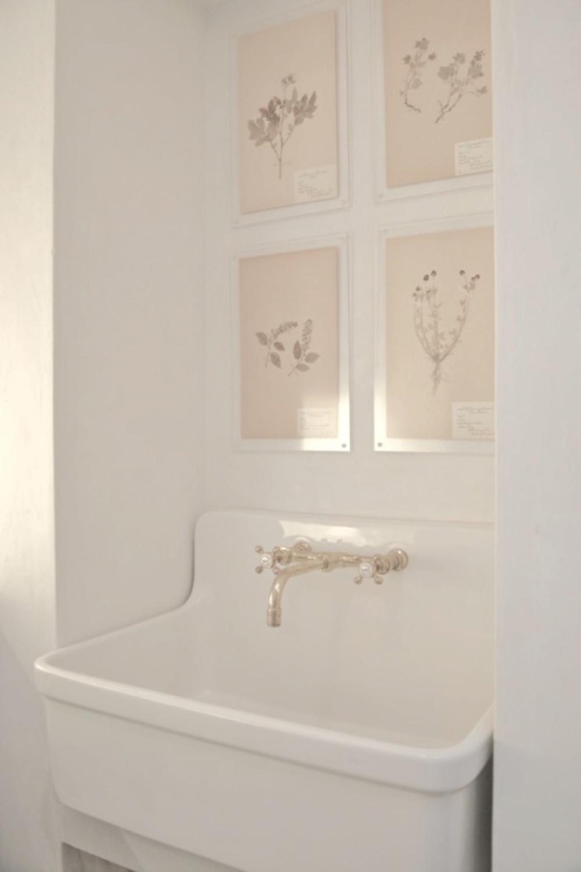 Kohler Gilford sink and botanical framed prints in Patina Farm laundry room - Brooke Giannetti of Velvet & Linen.