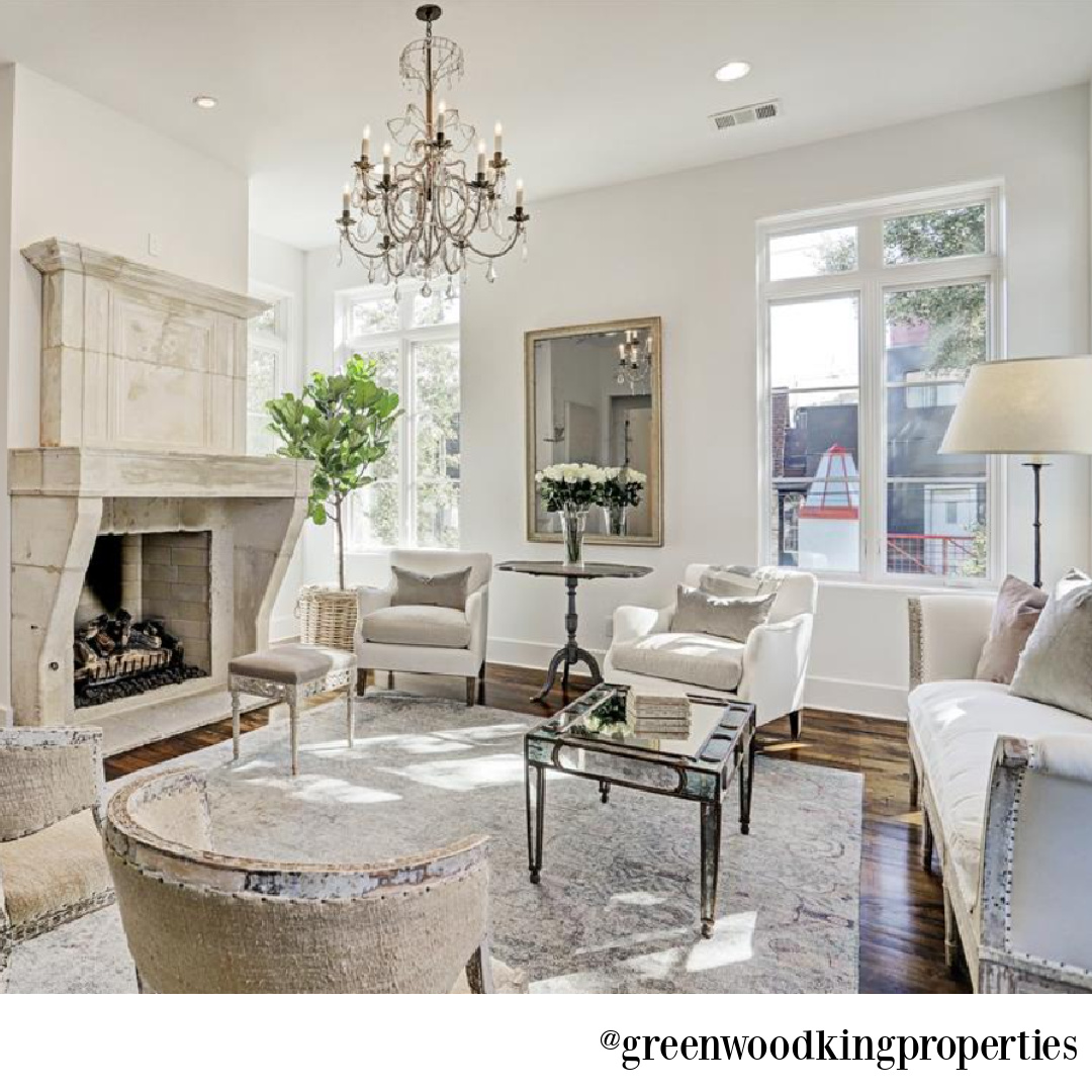 Sophisticated modern French white living room in a Houston home on Berthea with design by M Naeve - @greenwoodkingproperties