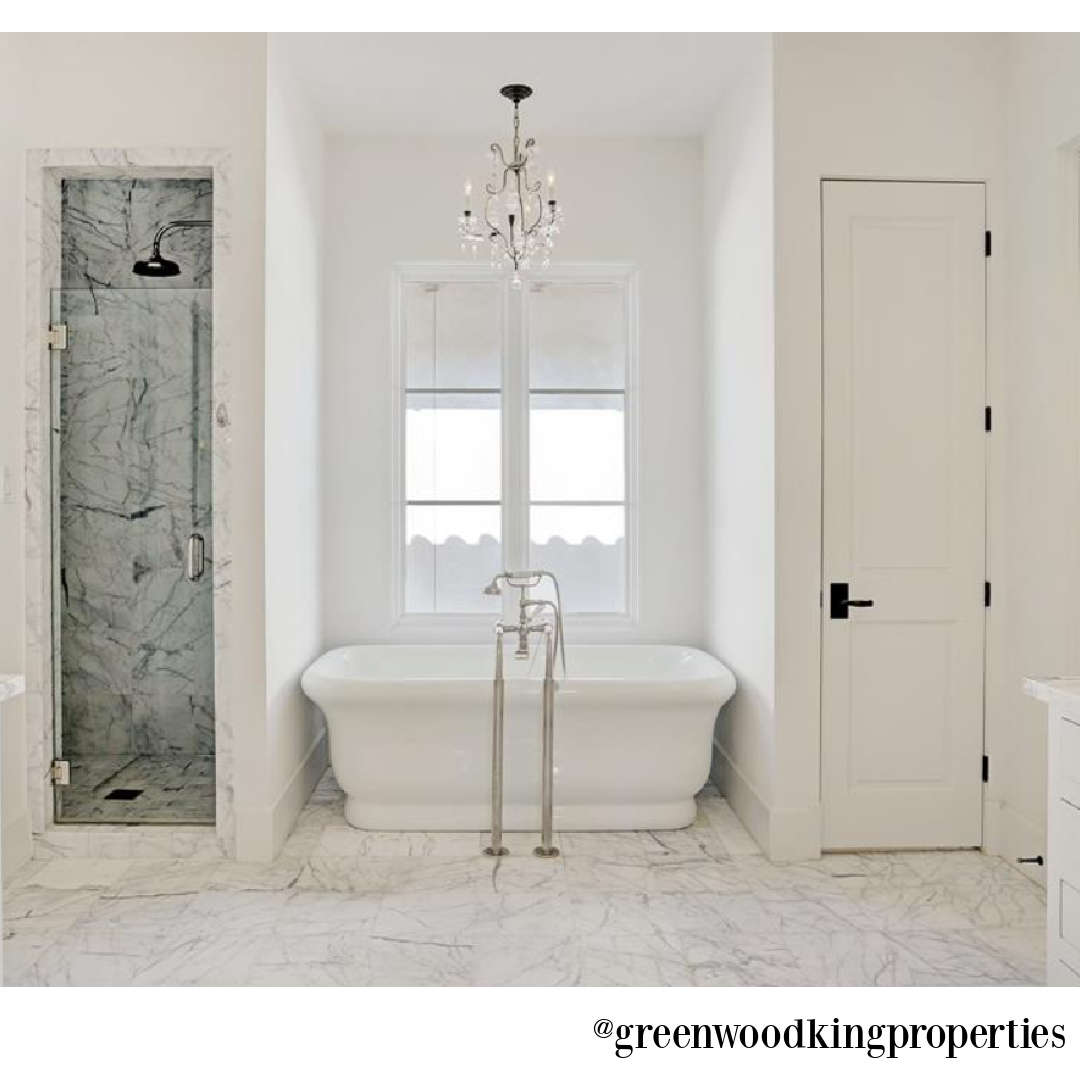 Soaker tub flanked by shower and closet in an elegant modern French Houston bath - @greenwoodkingproperties