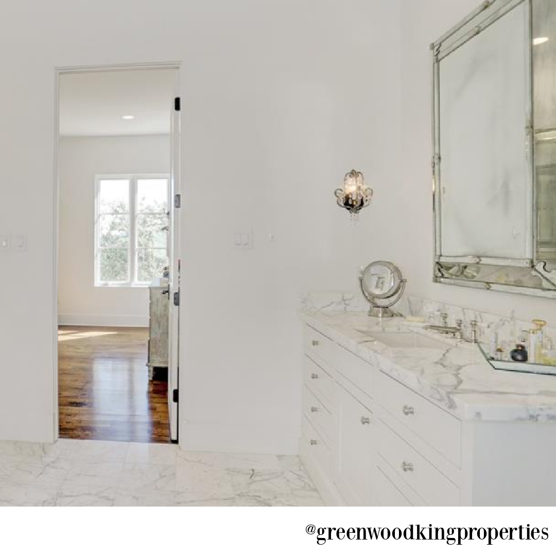Elegant white marble bathroom in a Houston home with interiors by M Naeve - @greenwoodkingproperties