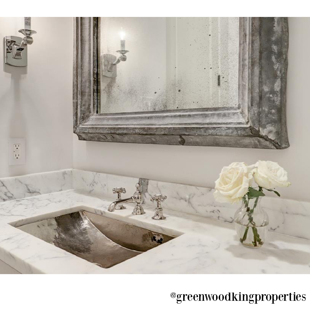 Carrera marble vanity, silver sink, and beautiful finishes in a modern French bath in Houston - M Naeve.