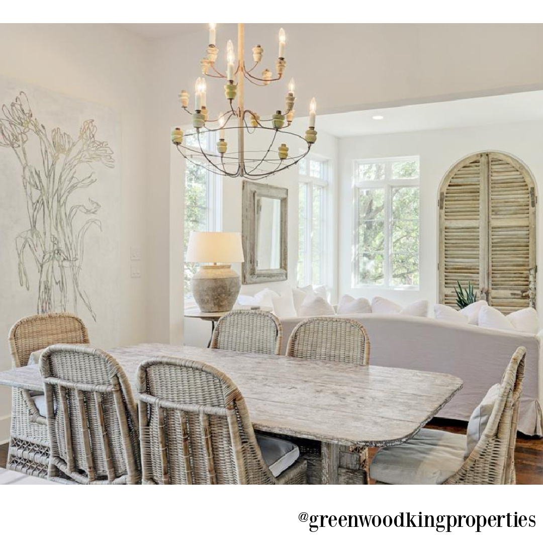 Modern French elegant white kitchen and dining area in a Houston home (115 Berthea) with interiors by M Naeve. #modernFrench #whitekitchens #frenchcountry