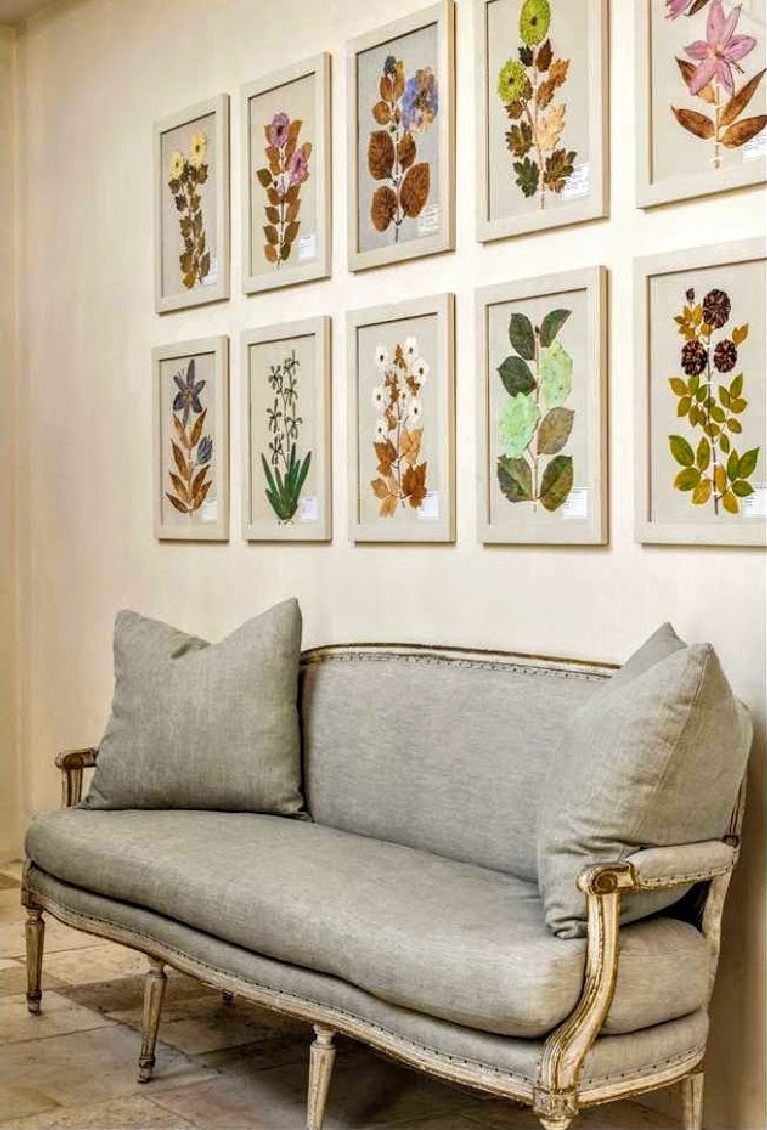 Lovely settee and botanical prints in French home with design by Pamela Pierce and architecture from Regan Andre. #pamelapierce #frenchcountry #interiordesign #oldworld #european #antiques #reaganandre