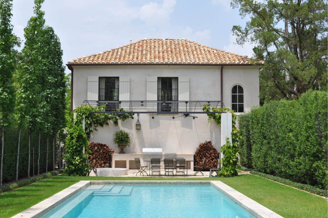Elegant French country house exterior and pool - design by Pamela Pierce; architecture by Regan Andre. #frenchcountry #exterior #houseexteriors #pool #housedesign #frenchhome