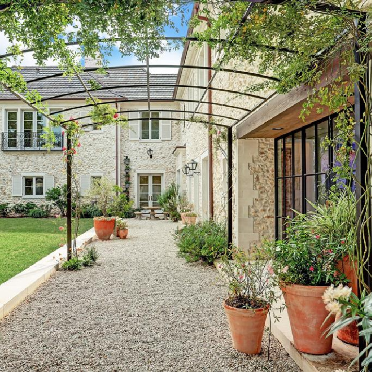 Breathtaking garden in French inspired Houston Home (2535 Inwood). #frenchcountry #housedesign #interiordesign #luxuryhome #frenchhome #sophisticateddecor