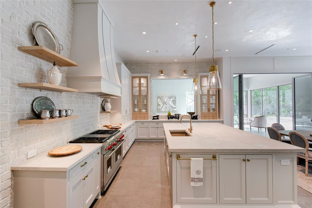 Dream kitchen in Stunning French inspired luxury home in Houston. #luxuryhome #frenchhome #frenchcountry #sophisticateddecor #timelessdesign #dreamkitchen #kitchens