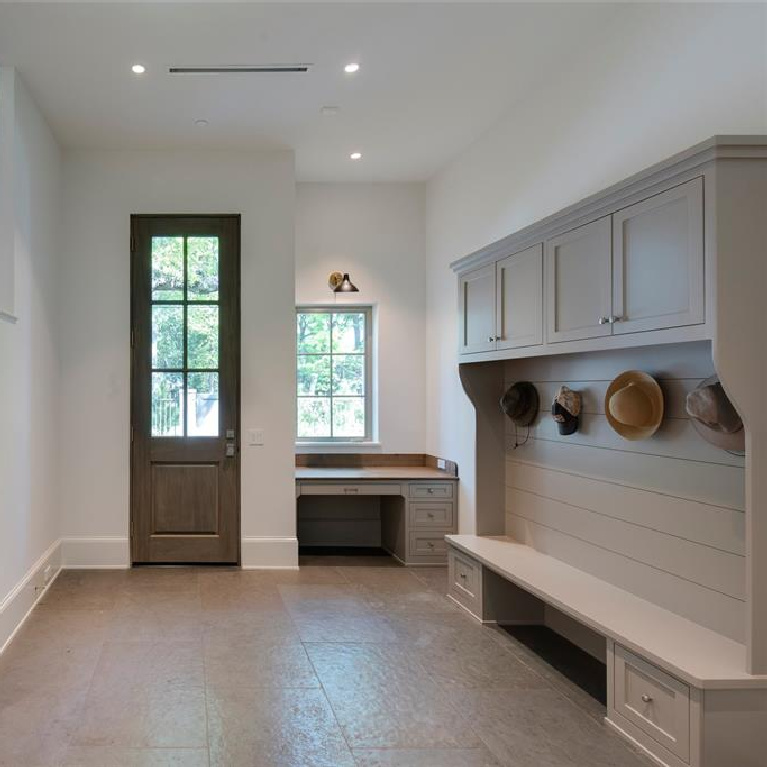 Mud room with 10' tall mahogany door in Stunning French inspired luxury home in Houston. #luxuryhome #frenchhome #frenchcountry #sophisticateddecor #timelessdesign