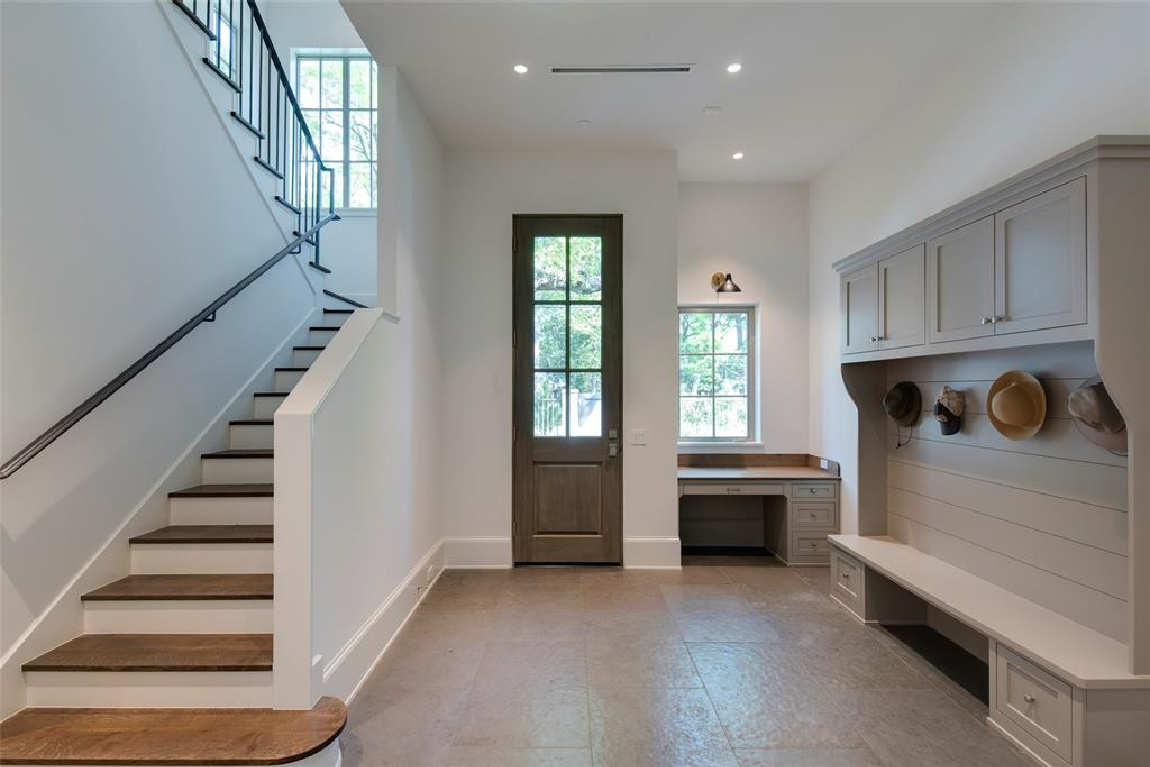 Mud room with builtin bench in Stunning French inspired luxury home in Houston. #luxuryhome #frenchhome #frenchcountry #sophisticateddecor #timelessdesign