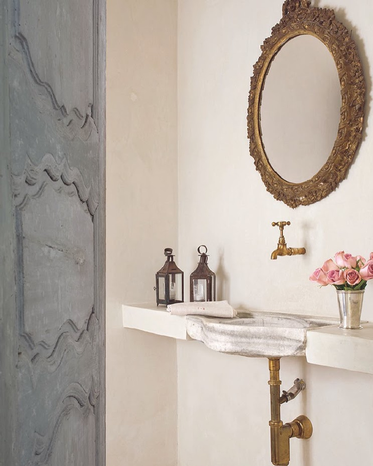 Elegant stone sink and antiques in a French country Houston home with design by Pamela Pierce. #interiordesign #frenchcountry #bathroomdesign #stonesink #frenchhome #oldworld #europeancountry #pamelapierce