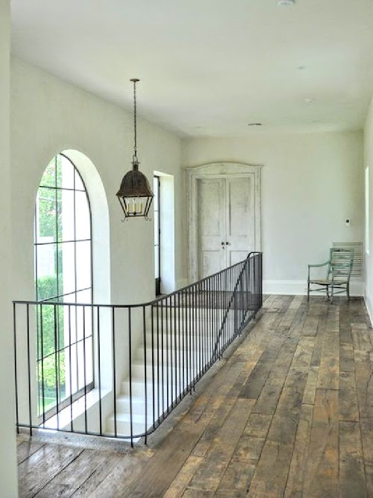 Exquisite French country home with iron staircase and reclaimed rustic wood floors from Chateau Domingue - design by Pamela Pierce. #frenchcountry #interiordesign #pamelapierce #staircase #reaganandre #chateaudomingue