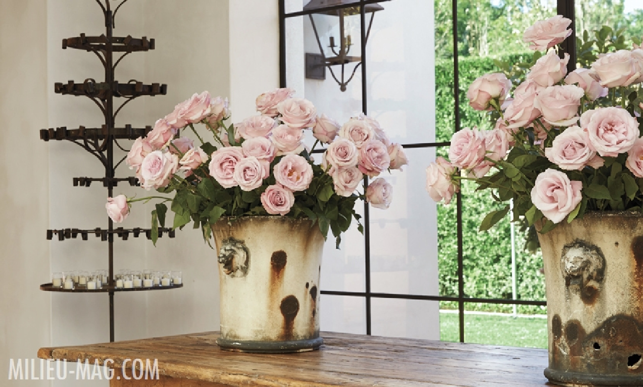 Pink roses and and antiques in a French country home with interior design by Pamela Pierce. #pamelapierce #frenchcountry #interiordesign #milieu #pinkroses #oldworld #antiques