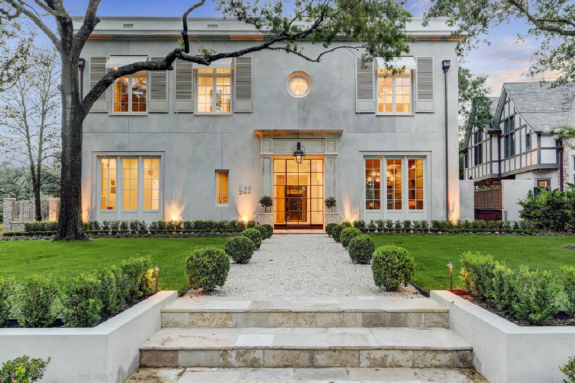 Stunning European elegance and curb appeal for this Houston home built by Morris Hullinger. #frenchcountry #houseexterior #dreamhome #stuccohome #europeancountry #houseexteriors