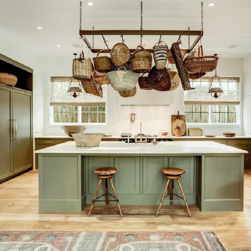 Luxurious Old World green kitchen with large island and pot rack - designed by Shannon Bowers for Milieu Showhouse 2020. #oldworldstyle #shannonbowers #europeancountry #kitchendesign #potrack