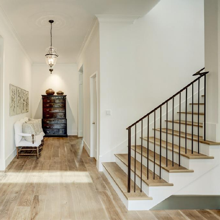 White oak flooring in hall and staircase in MILIEU Showhouse 2020 - featuring exceptional designers including Darryl Carter, Kathryn Ireland, Pamela Pierce, Shannon Bowers, and more. #milieushowhouse #interiordesign #designershowhouse #luxuryhome #edwinlutyens #houstonhome