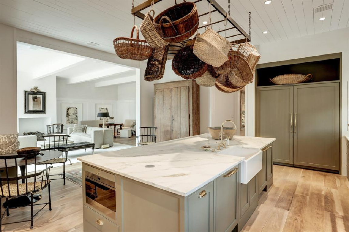 French baskets above kitchen island in MILIEU Showhouse 2020 - featuring exceptional designers including Darryl Carter, Kathryn Ireland, Pamela Pierce, Shannon Bowers, and more. #milieushowhouse #interiordesign #designershowhouse #luxuryhome #edwinlutyens #houstonhome #kitchendesign #shannonbowers