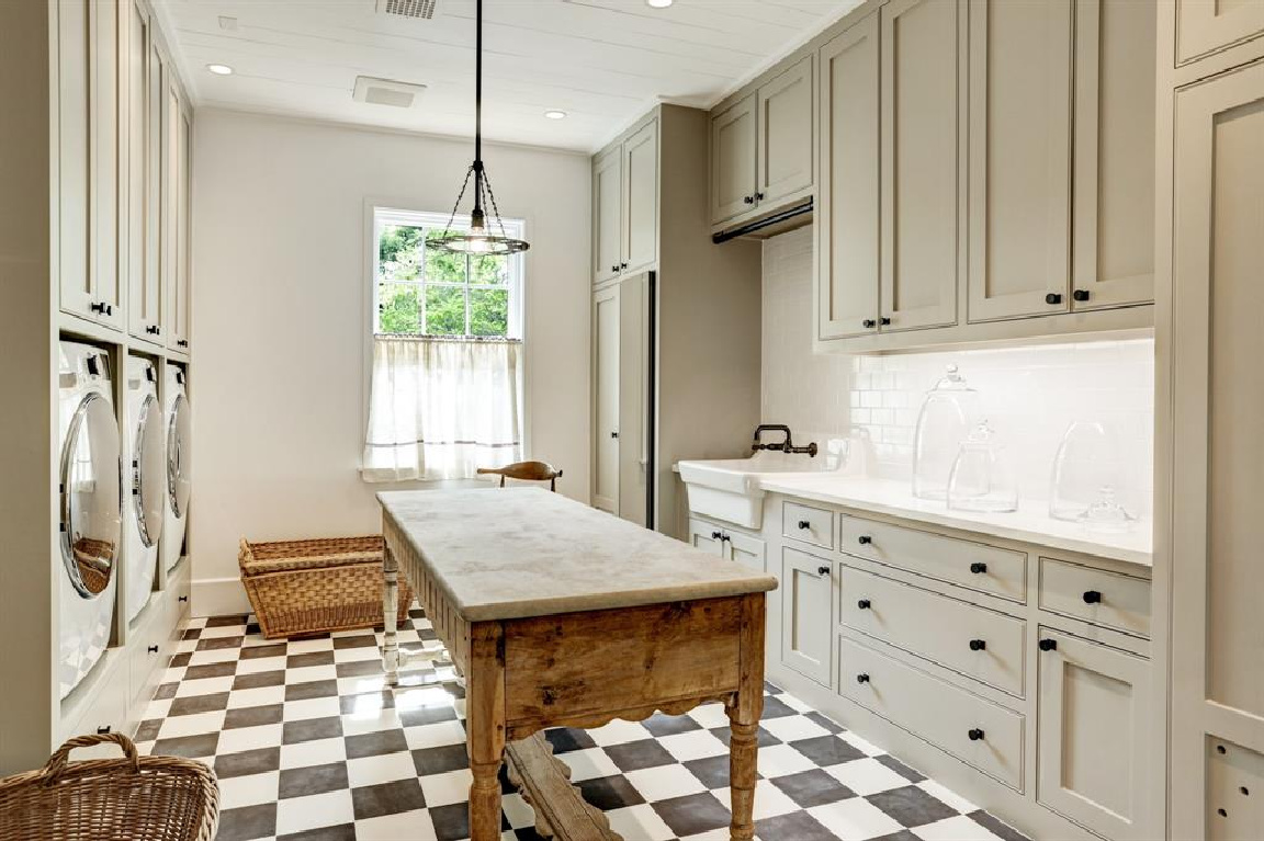 Laundry room with checker flooring in MILIEU Showhouse 2020 - featuring exceptional designers including Darryl Carter, Kathryn Ireland, Pamela Pierce, Shannon Bowers, and more. #milieushowhouse #interiordesign #designershowhouse #luxuryhome #edwinlutyens #houstonhome #laundryrooms