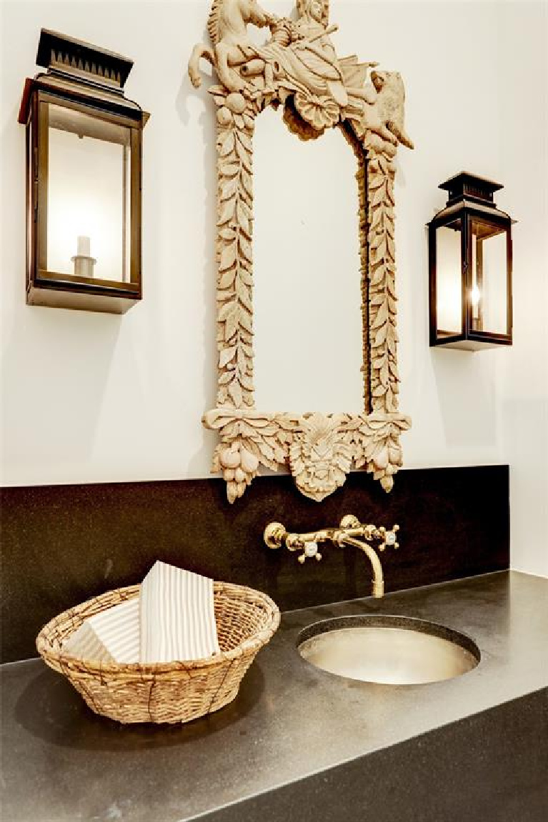 Powder room with lantern sconces in MILIEU Showhouse 2020 - featuring exceptional designers including Darryl Carter, Kathryn Ireland, Pamela Pierce, Shannon Bowers, and more. #milieushowhouse #interiordesign #designershowhouse #luxuryhome #edwinlutyens #houstonhome #bathroom