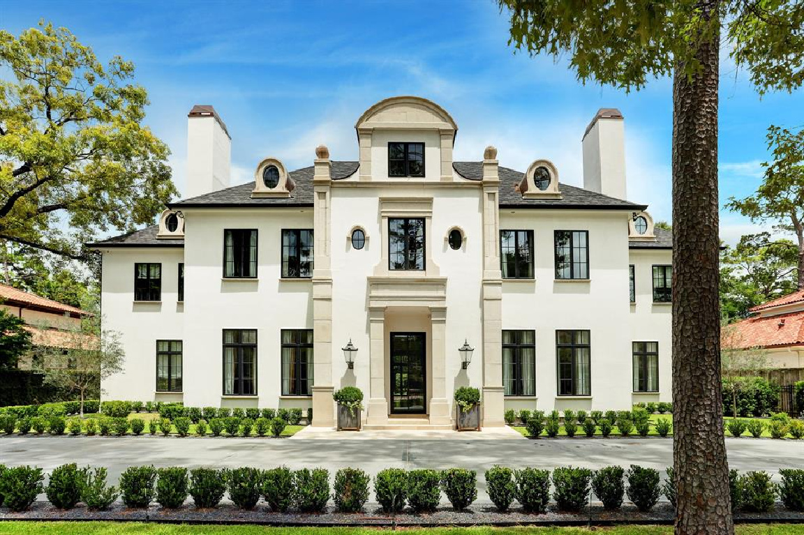 Stucco, cast stone, and limestone front facade of a magnificent European inspired Houston home by Charles W. Ligon. #houseexterior #luxuryhome #mansions #europeaninspired #houstonhome