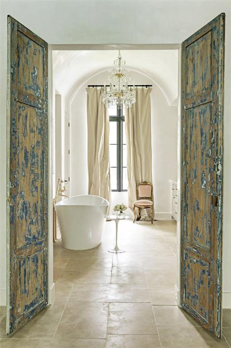 Luxurious French bathroom with soaking tub and sparkling chandelier. #bathroomdesign #frenchcountry #elegantdecor #luxuryhome #interiordesign