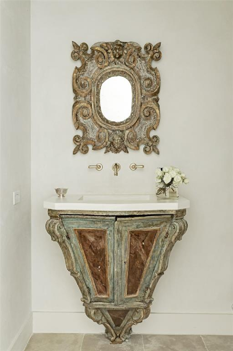 Segreto stone sink in antique Italian console and wall mounted brass faucet. #frenchcountry #bathroomdesign #segretostone #antiques #oldworldstyle #interiordesign