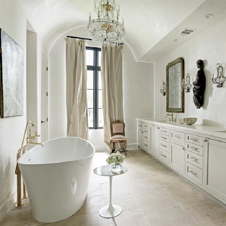 Luxurious French bathroom with soaking tub and sparkling chandelier. #bathroomdesign #frenchcountry #elegantdecor #luxuryhome #interiordesign