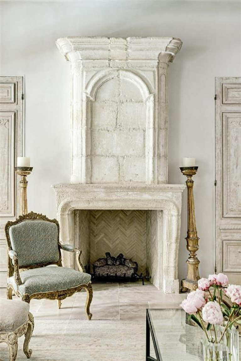 Pale and serene French interiors in a luxurious Houston home built with authentic European materials and bespoke finishes. #timelessdesign #interiordesign #frenchcountry #europeancountry #antiques #oldworldstyle #modernfrench #limestonefireplace #frenchmantel