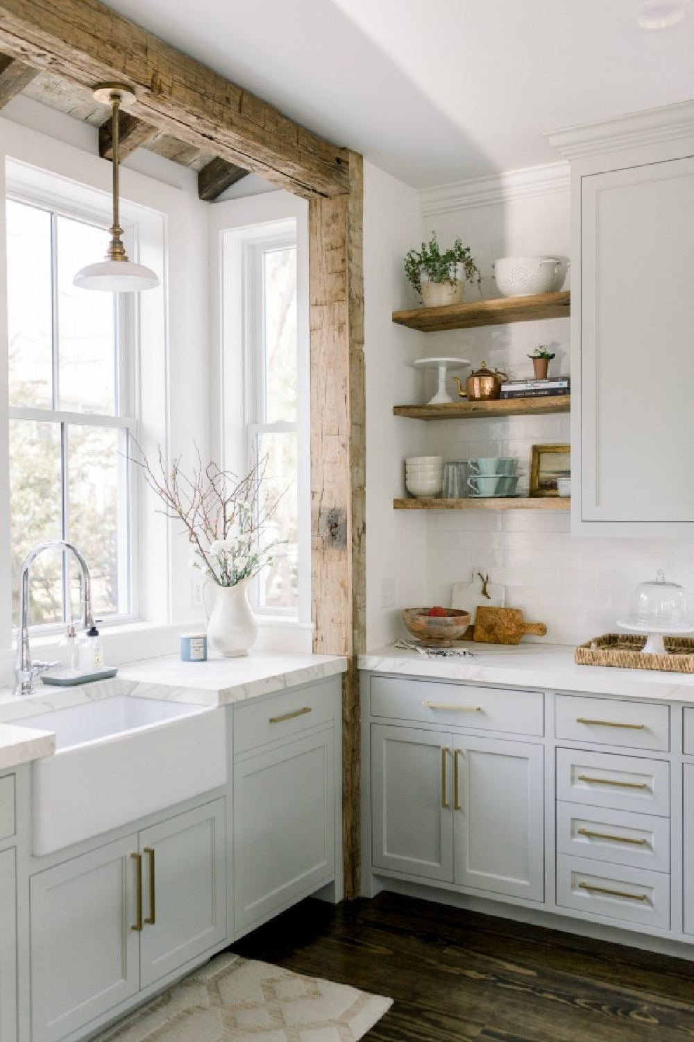 Elegant white farmhouse kitchen with Benjamin Moore Repose Grey cabinets, subway tile, gold accents, and reclaimed barn wood. Design: Finding Lovely.  See more Gorgeous European Country Interior Design Inspiration on Hello Lovely. #europeancountry #frenchfarmhouse #interiordesign