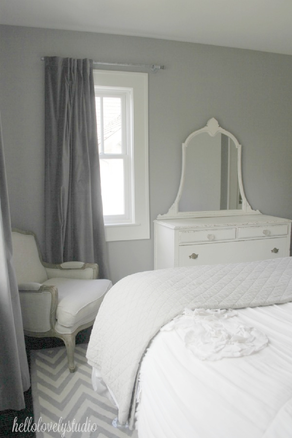 Platinum Gray (Benjamin Moore) paint color in a lovely romantic French country bedroom with white bedding and furniture. #hellolovelystudio #platinumgray #graypaintcolors