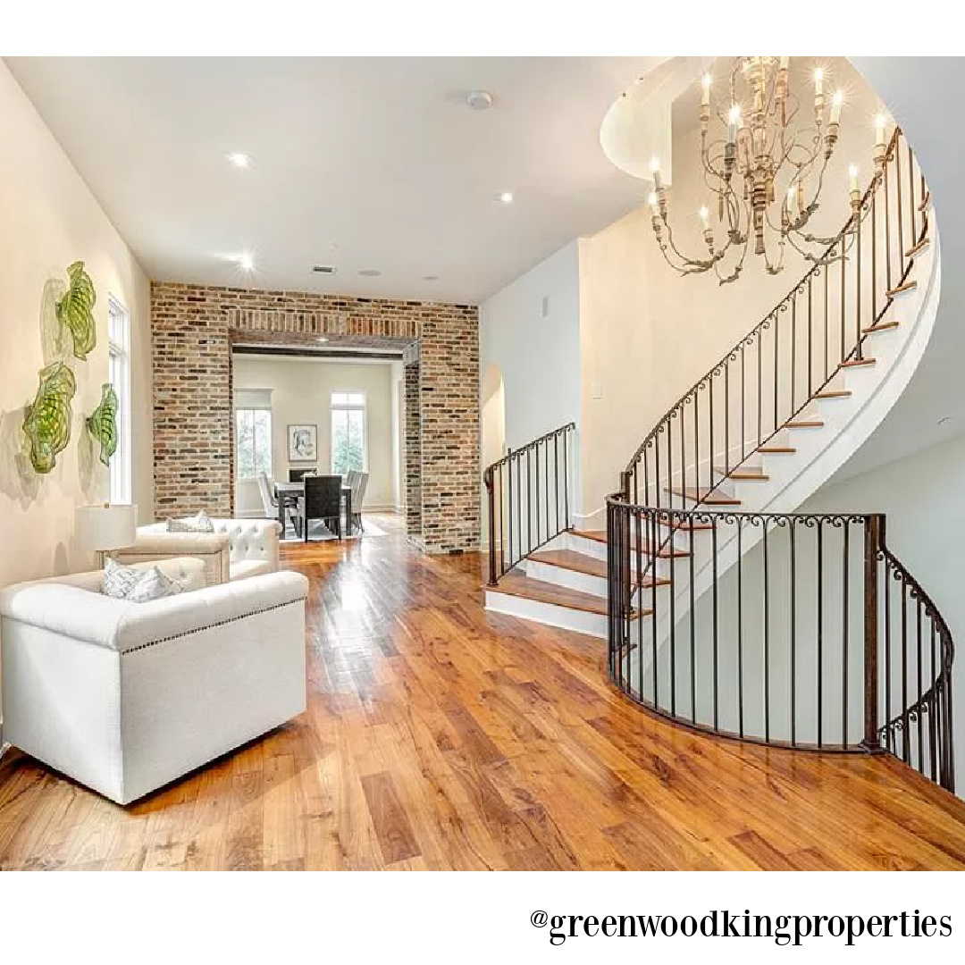 Staircase, wood floors, and chandelier in modern French Houston Home (1119 Berthea St.) - @greenwoodkingproperties. #modernfrench #interiordesign