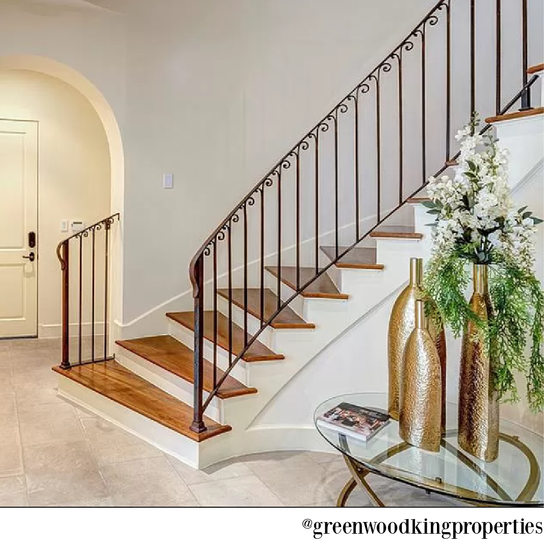 Staircase and arched doorway in modern French Houston Home (1119 Berthea St.) - @greenwoodkingproperties. #modernfrench #interiordesign