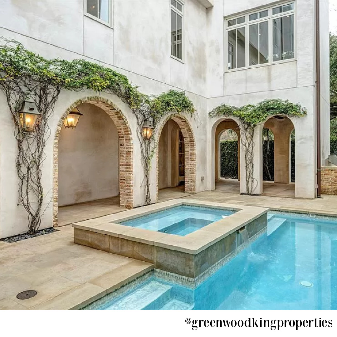 Pool and arches in modern French Houston Home (1119 Berthea St.) - @greenwoodkingproperties. #modernfrench #interiordesign #pools
