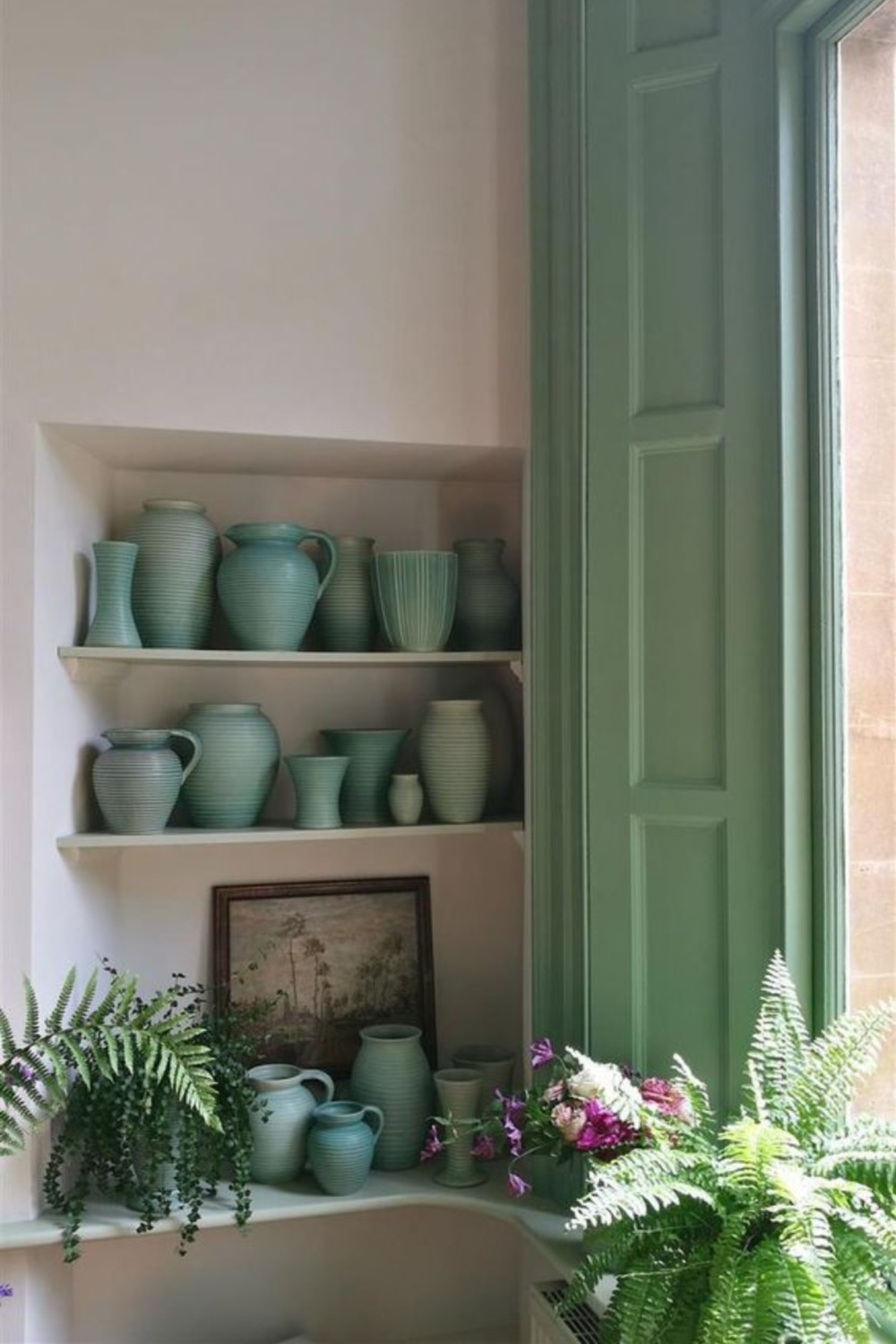 Breakfast Room Green (Farrow & Ball) shutters and light green and jadeite pottery on shelves with ferns. #breakfastroomgreen #greenpaintcolors