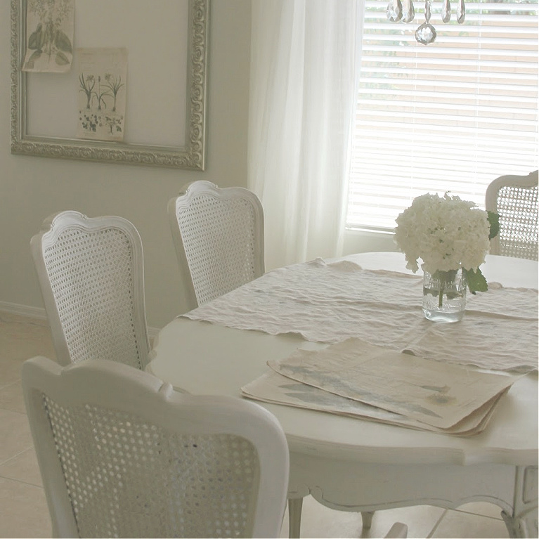 Beautiful serene shabby chic dining room with cane back chairs by Hello Lovely Studio. #diningroom #hellolovelystudio #shabbychic #frenchcountry