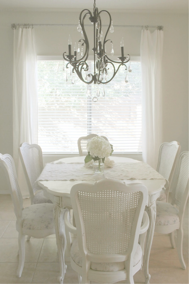 Beautiful serene shabby chic dining room painted Valspar Salute - Hello Lovely Studio. #diningroom #valsparsalute #hellolovelystudio #shabbychic #frenchcountry