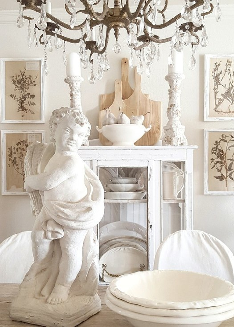 White accents in a French dining room with antiques and herbarium. #thefrenchnestco #frenchcountry #diningrooms