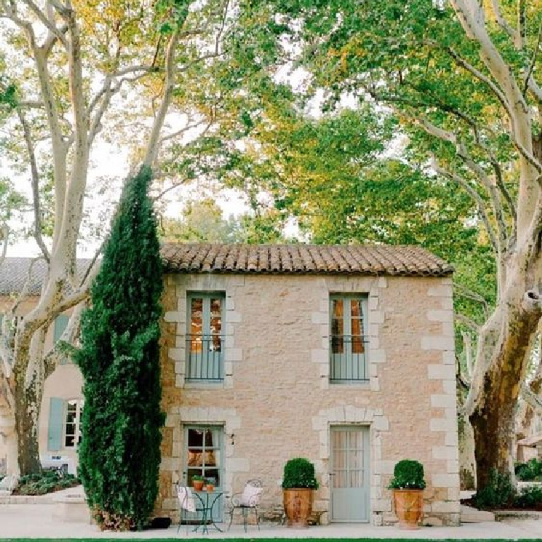 Charming stone guest house with green accents at Provence Poirers in France. #stonecottage #provence #romantichomes #houseexterior #cottageexterior #oldworldstyle