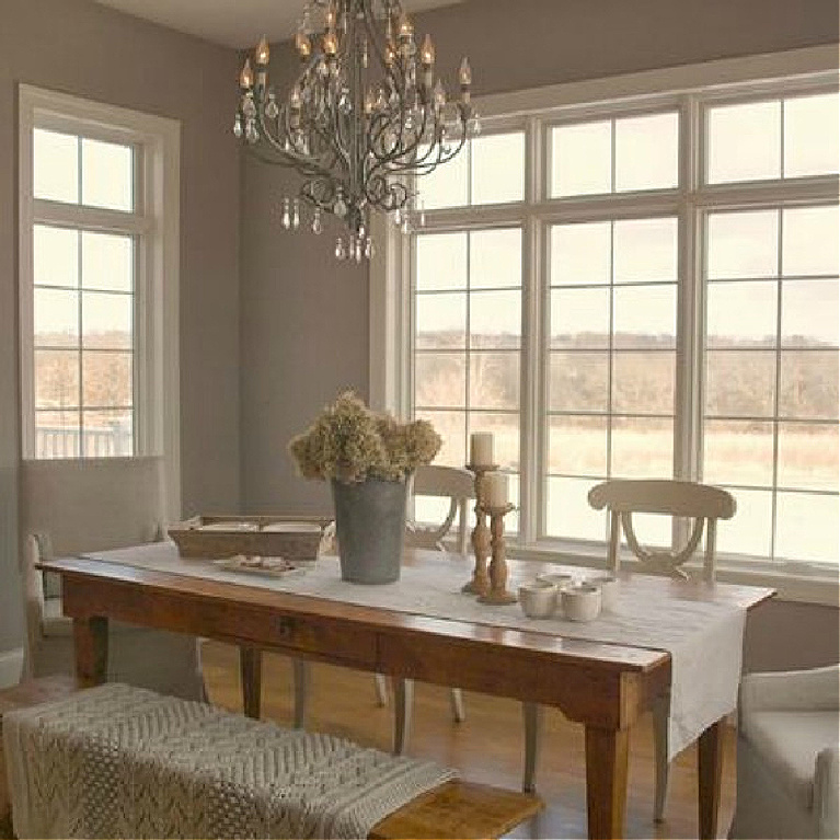 Serene and peaceful breakfast dining room with farm table and Swedish chairs - Hello Lovely Studio. #hellolovelystudio #diningroom #farmtable #frenchNordic #benjaminmoore #ashleygray