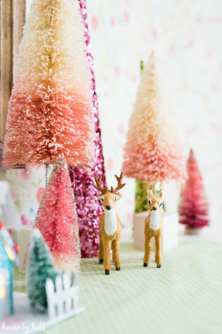 Pretty juicy pinks and cheerful blues for Christmas decor! In a girl's room, bottle brush Christmas trees and retro reindeer create a magical sweet vignette for the season. #houseofhoff #christmasdecor #bottlebrushtrees #retrochristmas #pinkchristmas #vintagestyle