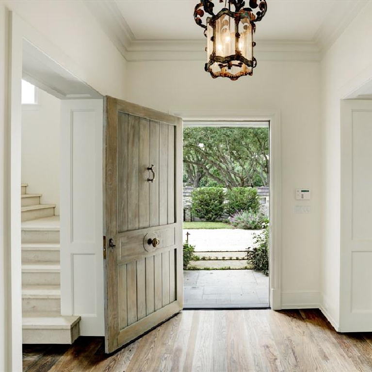 Stunning entry and wood plank front door in breathtaking French inspired Houston Home (2535 Inwood). Come see more old world new builds. #frenchcountry #housedesign #interiordesign #luxuryhome #frenchhome #enry