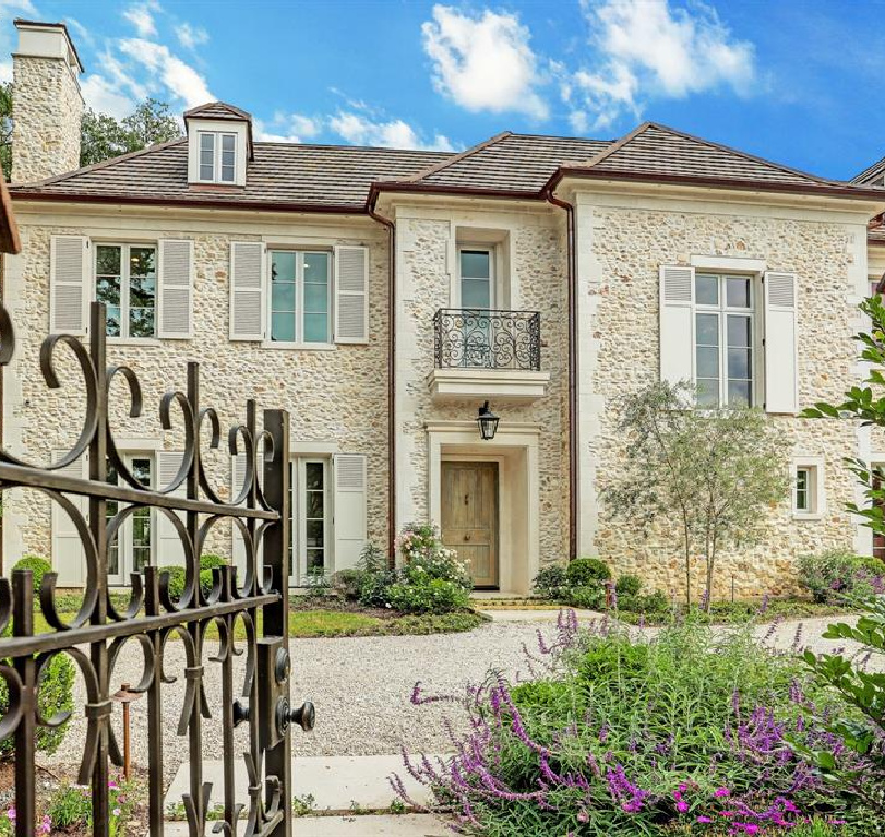 Front facade exterior of stunning staircase in breathtaking French inspired Houston Home (2535 Inwood). Come see more old world new builds! #frenchcountry #housedesign #interiordesign #luxuryhome #frenchhome #exterior