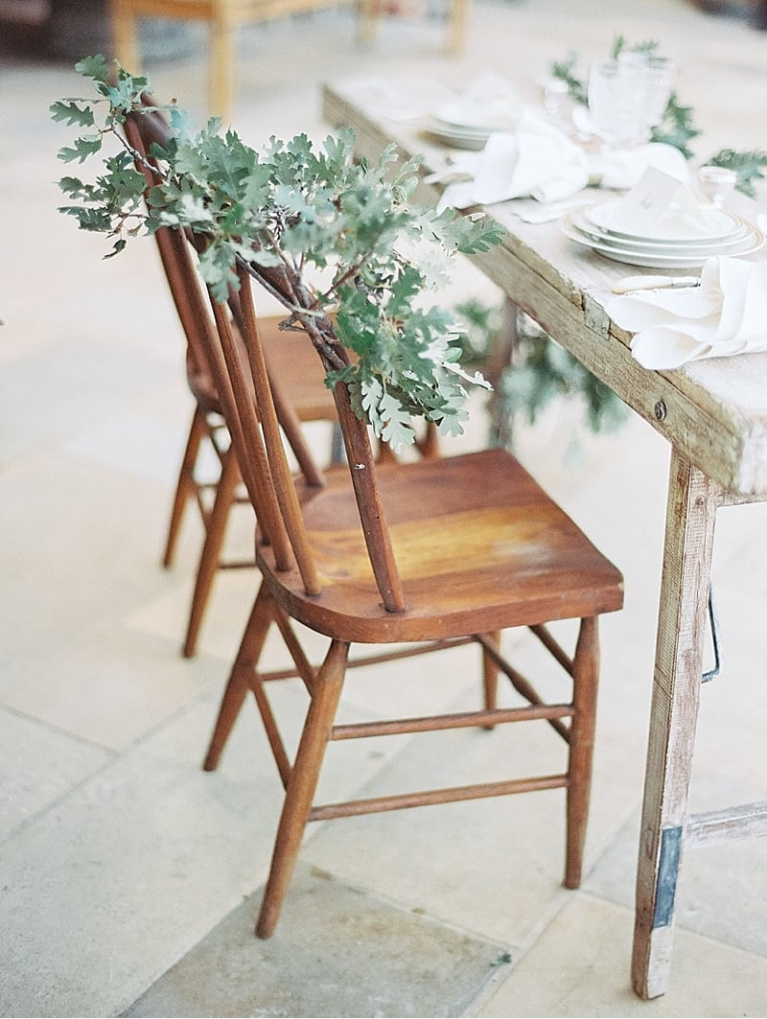Humble country chairs at distressed French farmhouse table. #frenchfarmhouse #dining #outdoordining