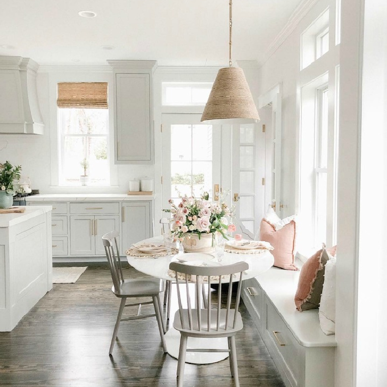 Elegant white farmhouse kitchen with Benjamin Moore Repose Grey cabinets, subway tile, gold accents, and reclaimed barn wood. Design: Finding Lovely. Wall color: Benjamin Moore Chantilly Lace. #paintcolors #bestwhites #interiordesign