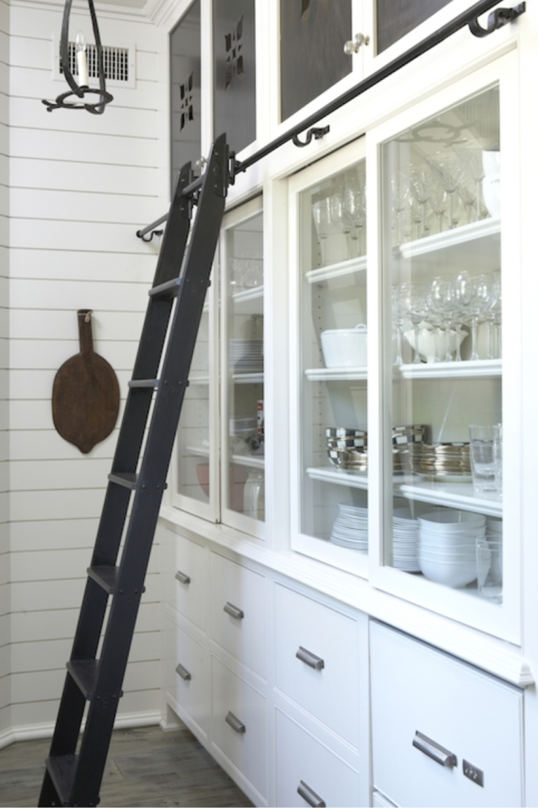 Shiplap painted Benjamin Moore China White in a stunning kitchen with sliding library ladder by Tracery Interiors. #benjaminmoore #chinawhite #bestwhites #paintcolors #kitchendeor #shiplap