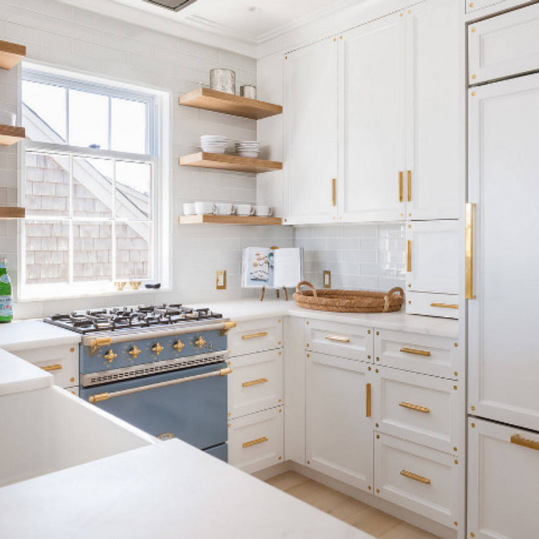 Benjamin Moore Decorators White on cabinet in a beautiful kitchen with blue Lacanche range - Elizabeth Walker Raith. #benjaminmoore #decoratorswhite #paintcolors #whitepaint #bestwhites #kitchendecor #modernfarmhousekitchen