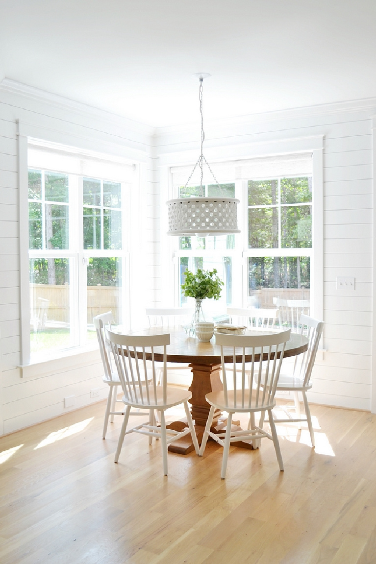 Sherwin Williams Extra White paint color on walls of breakfast room - Chrissy Marie Blog. #sherwinwilliams #extrawhite #whitepaintcolors #paintcolors #interiordesign #bestwhites