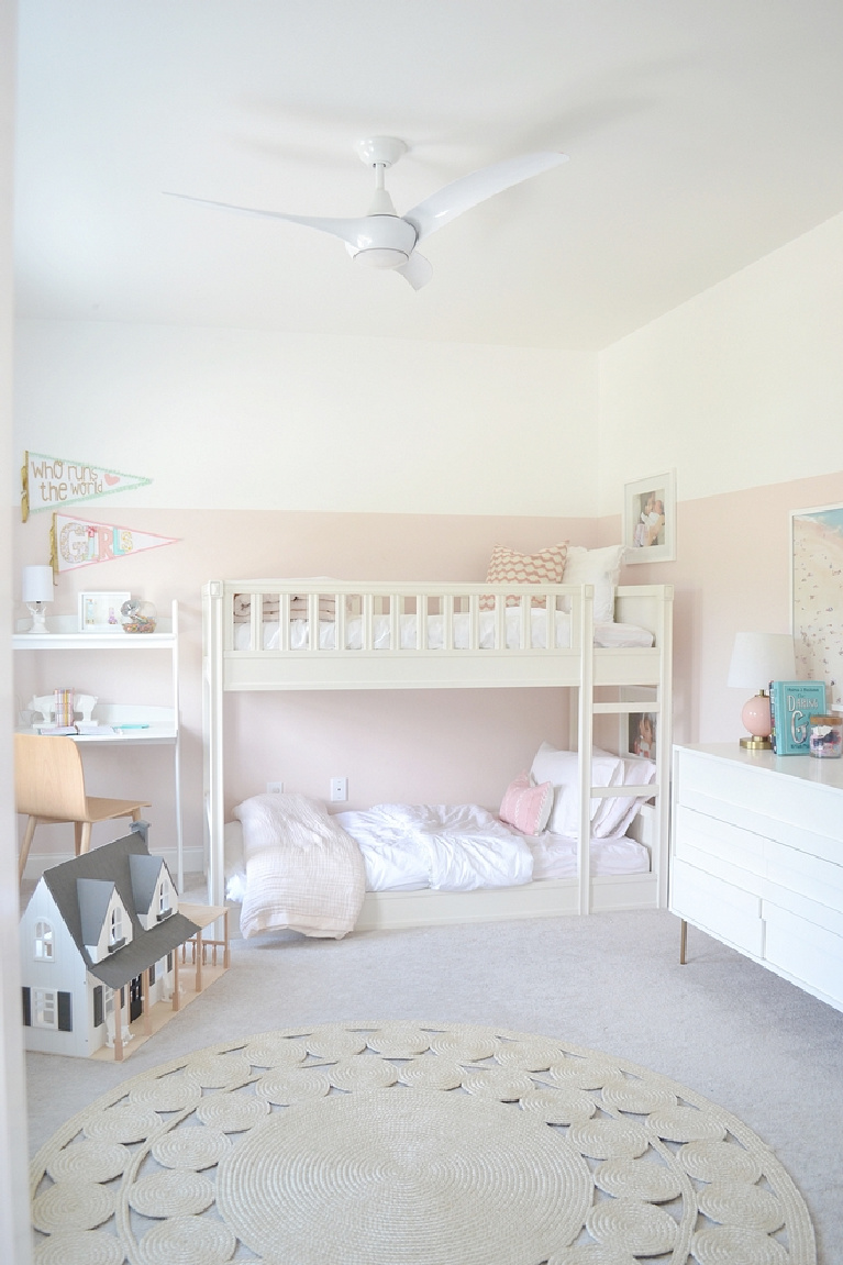 Sherwin Williams Extra White paint color on walls in girls bedroom. Pink paint is Valspar Sweet Pastel - Chrissy Marie Blog. #sherwinwilliamsextrawhite #paintcolors #bestwhites #valsparsweetpastel #pinkwalls #interiordesign #bedroomdecor